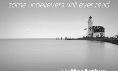 John MacArthur Quote - The Bible to Unbelievers - lighthouse in black and white