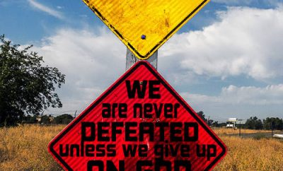 "Ronald Reagan Quote - ""We are never defeated unless we give up on God."""